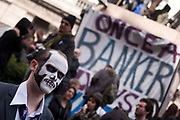 Protesters gather to deomontstrate against various issues outside the Bank of England in the heart of the City of London. Issues such as anti climate change, capitalism and those against the credit crisis were the main points of the day. Bankers being a particular target of protest. This protester is dressed and made up as a dead banker, in a suit as a skeleton