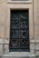 Ornate Paris Door at Church of Saint Peter of Montmartre or Paroisse Saint Pierre de Montmartre - Thousands of doors and gates adorn buildings in Paris.  Some of the best are on government offices, cathedrals and churches, as well as a few chateau.  However, any self-respecting contractor with a decent budget probably spent a lot of consideration in installing suitable doors, windows, grill work and even doorknobs. Some of these gates, doors and windows are very simple, while others are extravagant works of art. The styles of these doors tell about the history of France. As you walk across the 20 arrondissements of Paris, you will discover Gothic, Renaissance, Haussmann and Art Nouveau door styles. It is up to you to take the time to look for little details of these Paris' most beautiful doors with statues, bas-reliefs, mascarons, gold-leaf, grills, handles and door knobs.