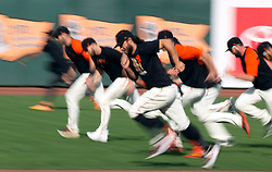 Oct 7, 2021; San Francisco, CA, USA; San Francisco Giants players run wind sprints during NLDS workouts. Mandatory Credit: D. Ross Cameron-USA TODAY Sports