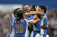 Photo: Lee Earle.<br /> Portsmouth v Reading. The Barclays Premiership. 28/10/2006. Portsmouth's Kanu (2ndR) is mobbed after scoring their second.