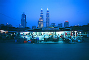 Diner in Kuala Lumpur with the Petronas Towers of  Malaysia in the background.