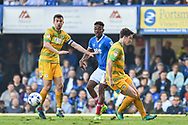 Portsmouth goalscorer Forward, Jamal Lowe (18) takes on the Yeovil Town defence during the EFL Sky Bet League 2 match between Portsmouth and Yeovil Town at Fratton Park, Portsmouth, England on 8 April 2017. Photo by Adam Rivers.