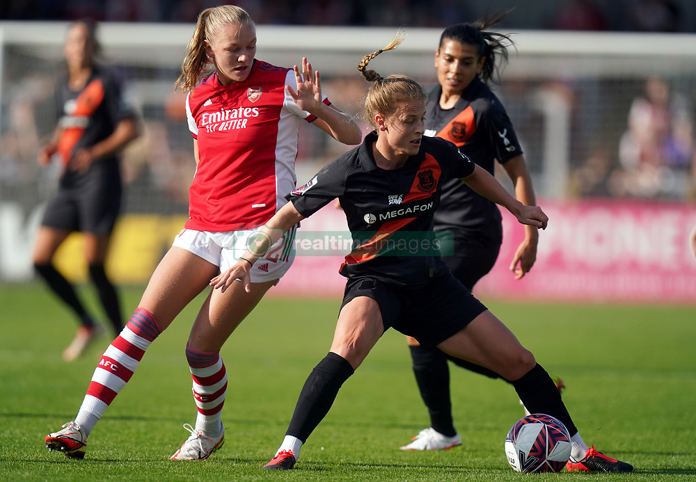Everton Women's Anna Anvegard (centre) and Arsenal Women's Frida Maanum (left) battle for the ball during the FA Women's Super League match at Meadow Park, Borehamwood. Picture date: Sunday October 10, 2021.