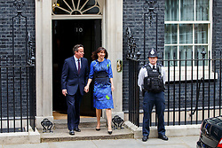 © Licensed to London News Pictures. 08/05/2015. LONDON, UK. Prime minister and Conservatives leader David Cameron and Samantha Cameron leaving Downing Street to visit the Queen for a formal permission to form a Conservative majority government on Friday, 8 May 2015 following the 2015 General Election. Photo credit : Tolga Akmen/LNP