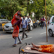 1 May 2021<br /><br />Indirapuram, Gazhiabad<br />A man brings his wife  who  was  struggling to breathe to the Indirapuram Gurudwara ( Sikh Temple) where a free oxygen camp has been organised for Covid positive patients who have not found a hospital or oxygen support . A massive spike in cases caught the administration and hopsitals unprepared , this  in the national capital region. Lack of hospital beds , oxygen and ICU facilities has meant good samaritans are stepping up and trying to fill the gaps.