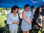 03 JULY 2019 - WEST DES MOINES, IOWA: US Senator KAMALA HARRIS, left, (D-CA)  during a moment of silence for dead migrants at the West Des Moines Democrats' annual 4th of July Picnic. Senator Harris attended the picnic to support her bid to be the Democratic nominee for the US presidency in 2020. Iowa hosts the first presidential selection event of the 2020 election cycle. The Iowa Caucuses are scheduled for Feb. 3, 2020.       PHOTO BY JACK KURTZ