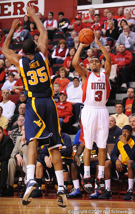 Feb 22, 2009; Piscataway, NJ, USA; Rutgers guard Mike Rosario (3) takes a shot over the block of West Virginia forward Wellington Smith (35) during the first half of Rutgers' 74-56 loss to West Virginia at the Louis Brown Athletic Center.