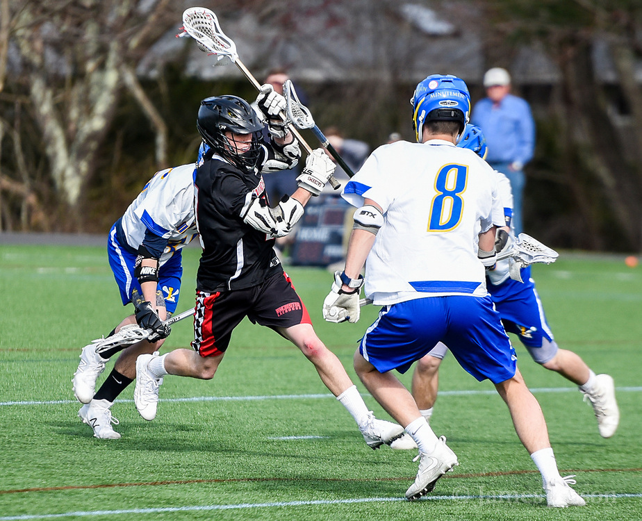 Winchester High School sophomore Grant Murray takes a shot on goal during the game against Lexington High School in Lexington, April 24, 2018. Winchester won the game, 11-6.   [Wicked Local Photo/James Jesson]