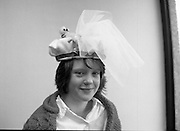 Easter Bonnet Competition.  (R54)..1987..16.04.1987..04.16.1987..As part of an Easter Promotion The Kilkenny Design Shop in Nassau Street, Dublin sponsored an Easter bonnet design competition. There follows a series of images showing some of the fabulous designs put forward. Unfortunately we do not have the caption card naming the individuals who took part, if you know any of them why not let us know at irishphotoarchive.ie and we will gladly add to the caption...Image shows one of the entrants in the Easter Bonnet competition sponsored by The Kilkenny Design Shop, Nassau Street,Dublin.