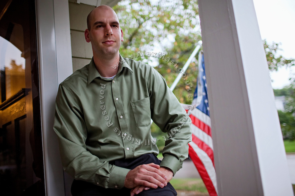 Benjamin Tippetts, 27, is sitting in front of his home in La Crosse, WI, USA, where he works as a freelance financial advisor. He lives with his wife and his newborn daughter. Benjamin has been an Army infantryman in Fallujah, fighting in the 2nd battle in 2004.