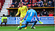 Lee Foderingham blocks Daniel Powell's shot during the Sky Bet League 1 match between Swindon Town and Milton Keynes Dons at the County Ground, Swindon, England on 4 April 2015. Photo by Alan Franklin.