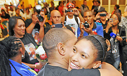 Cape Town - 140831 - Pictured is Gezelle Magerman hugging biological father, John Hoogbaard. Gezelle Magerman received a hero's welcome at the Cape Town International Airport. She won South Africa's first medal of the 2014 Youth Olympic Games, taking gold in the women's 400m hurdles in Nanjing, China. Reporter: Kieran Legg Picture: David Ritchie (083 652 4951)