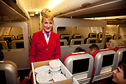 CRAWLEY, WEST SUSSEX, UK, OCTOBER 27TH 2011. Journalist / writer Andrea Sachs performs cabin duties during research on a story about Virgin Atlantic air stewardess and steward training at The Base training facility. (Photo by Mike Kemp for The Washington Post)