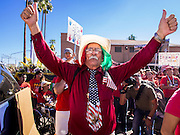 05 OCTOBER 2013 - PHOENIX, ARIZONA:  An elderly man cheers during an immigration reform rally in Phoenix. More than 1,000 people marched through downtown Phoenix Saturday to demonstrate for the DREAM Act and immigration reform. It was a part of the National Day of Dignity and Respect organized by the Action Network.   PHOTO BY JACK KURTZ