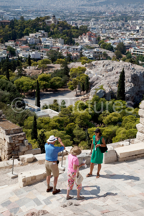 Tourists and visitors climbing up the marble stept towards the Acropolis of Athens. The main buildings on the Acropolis were built by Pericles in the fifth century BC as a monument to the cultural and political achievements of the inhabitants of Athens. The term acropolis means upper city and many of the city states of ancient Greece are built around an acropolis where the inhabitants can go as a place of refuge in times of invasion. It's for this reason that the most sacred buildings are usually on the acropolis. It's the safest most secure place in town. As little as 150 years ago there were still dwellings on the Acropolis of Athens. Athens is the capital and largest city of Greece. It dominates the Attica periphery and is one of the world's oldest cities, as its recorded history spans around 3,400 years. Classical Athens was a powerful city-state. A centre for the arts, learning and philosophy.