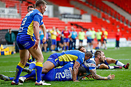 Featherstone Rovers stand off Martyn Ridyard (6) on the floor plays the ball out of the tackle during the Challenge Cup 2018 match between Doncaster and Featherstone Rovers at the Keepmoat Stadium, Doncaster, England on 22 April 2018. Picture by Simon Davies.