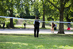 © Licensed to London News Pictures. 21/07/2020. London, UK. A police officer guards the crime scene in Finsbury Park, north London, following triple stabbings. Police officers were called at 2.51pm to reports of stabbings and assault in Finsbury Park, north London. It has been reported that a group of men, who were intoxicated were involved in a fight. One man has been arrested. Photo credit: Dinendra Haria/LNP