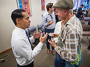 17 OCOTBER 2019 - DES MOINES, IOWA: JULIÁN CASTRO, former Secretary of Housing and Urban Development for President Barack Obama, talks to a person about climate change after speaking at Urban Dreams, a human services agency for under served communities in Des Moines. Castro is visiting Iowa to support his bid to be the Democratic nominee for the US Presidency. Iowa traditionally hosts the the first selection event of the presidential election cycle. The Iowa Caucuses will be on Feb. 3, 2020.                  PHOTO BY JACK KURTZ