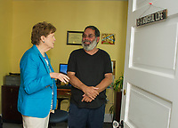 Senator Jeanne Shaheen talks with Recovery Coach Gary Ranno during Shaheen's tour of the new Navigating Recovery facility on Court Street in Laconia.  (Karen Bobotas/for the Laconia Daily Sun)