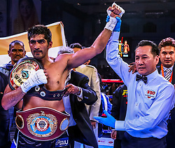 December 23, 2017 - Jaipur, Rajasthan, India - An Indian Boxer Vijender Singh  won match against Ghana's  Boxer Ernest Amuzu  during the  WBO Asia Pacific and WBO Oriental Super Middleweight Championship at SMS Indoor Stadium in Jaipur ,Rajasthan,India on 23 December 2017.Vijender Singh beats Ernest Amuzu for 10th successive victory, defends his WBO Asia Pacific and Oriental titles against Ghana's Ernest Amuzu in a Super Middleweight clash. (Credit Image: © Vishal Bhatnagar/NurPhoto via ZUMA Press)