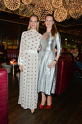 Left to right, sisters POPPY DELEVINGNE and CHLOE GRANT at the Launch Of Osman Yousefzada's 'The Collective' 4th edition with special guest collaborator Poppy Delevingne held in the Rumpus Room at The Mondrian Hotel, 19 Upper Ground, London SE1 on 24th November 2014, sponsored by Storm models and Beluga vodka.