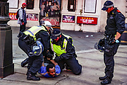 Blood stain is seen on the ground as the police officers arrested a homeless man, who said to be a supporter of the BLM at Piccadilly Circus in central London, Saturday, June 13, 2020. <br /> Anger against systemic levels of institutional racism has raged through the city, and worldwide; sparked by the death of George Floyd, who was killed in Minneapolis, US, by a policeman who restrained him with force on 25 May 2020. (Photo/ Vudi Xhymshiti)