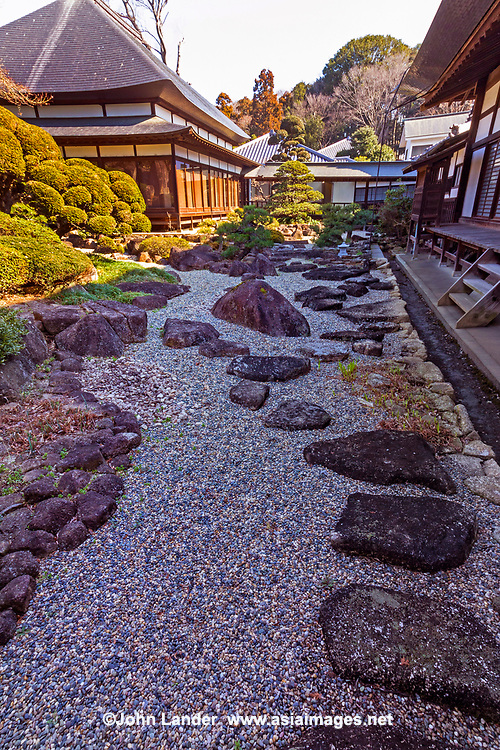 Chokokuji Temple Zen Garden - Chokoku-ji is a vast temple compound of Rinazai sect of Zen Buddhism in Saitama, just north of Tokyo. Behind the main hall there is an expansive Zen garden, though it is rarely open to visitors but can be seen from the side of the building.  It was once associated with the Ashikaga and Tokugawa  families and is now a part of Kenchoji Kamakura branch of Rinzai.  Rather than a mere tourist attraction, it is an active temple and monastery despite the fact that it is a very attractive place with landscaped Japanese gardens, an impresive gate with carved wooden bas reliefs.