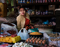 MRAUK U, MYANMAR - CIRCA DECEMBER 2017: Portrait of a burmese woman in the Mrauk U market.