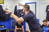 AFC Wimbledon goalkeeping coach Ashley Bayes dancing in the dressing room during the EFL Sky Bet League 1 match between AFC Wimbledon and Bristol Rovers at the Cherry Red Records Stadium, Kingston, England on 19 April 2019.