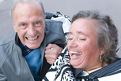 Woman with Spina Bifida with her arm around her father and carer whilst enjoying a day trip to Skegness organised by the Nottingham Disabled Friendship Club,