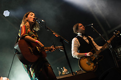 """© Licensed to London News Pictures. 16/07/2013. London, UK.   Of Monsters and Men performing live at Somerset House. In this pic - Nanna Bryndís Hilmarsdóttir (left) and Brynjar Leifsson (right).  Of Monsters and Men is a six-piece, English-language, indie folk/pop band from Iceland consisting of lead singer/guitarist Nanna Bryndís Hilmarsdóttir, co-singer/guitarist Ragnar """"Raggi"""" Þórhallsson, guitarist Brynjar Leifsson, drummer Arnar Rósenkranz Hilmarsson and bassist Kristján Páll Kristjánsson.  Photo credit : Richard Isaac/LNP"""