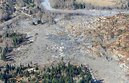 The west end (upper left) and east end (lower right) of highway 530 is seen with the massive mudslide that covered the area between in Oso, Washington March 31, 2014. Recovery teams struggling through thick mud up to their armpits and heavy downpours at the site of the devastating landslide in Washington state are facing yet another challenge - an unseen and potentially dangerous stew of toxic contaminants. REUTERS/Rick Wilking (UNITED STATES)