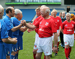 England's Tommy Charlton (middle) shakes hands with the Italian players on his England debut before the Walking Football International match at The AMEX Stadium, Brighton.