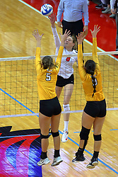 23 November 2017:  Ella Francis attacks over Sydney Bronner and Brittany Anderson during a college women's volleyball match between the Valparaiso Crusaders and the Illinois State Redbirds in the Missouri Valley Conference Tournament at Redbird Arena in Normal IL (Photo by Alan Look)