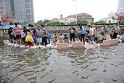 BEIJING, CHINA - JULY 20: <br /> <br /> Citizens protect subway station from floodwater on July 20, 2016 in Tianjin, China. Tianjin Meteorological Observatory has issued an orange alert to heavy rainfall at 08:07 am early Wednesday and the rainstorm is predicted to continue in following six hours. <br /> ©Exclusivepix Media