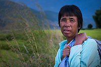 BHUTAN - CIRCA OCTOBER 2014: Bhutanese woman returning home from a rice field in the countryside in Bhutan