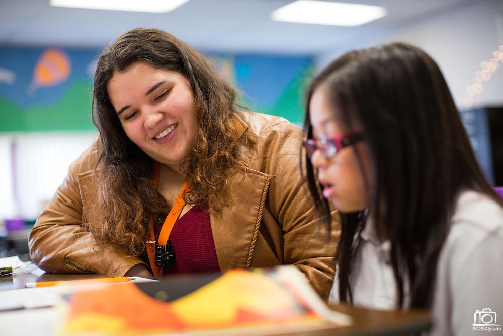 Reading Partners Regional Site Coordinator Stephanie Entizne tutors third grader Natalie Truong, 8, during the Reading Partners tutoring program at Rose Elementary School in Milpitas, California, on December 8, 2014. (Stan Olszewski/SOSKIphoto)