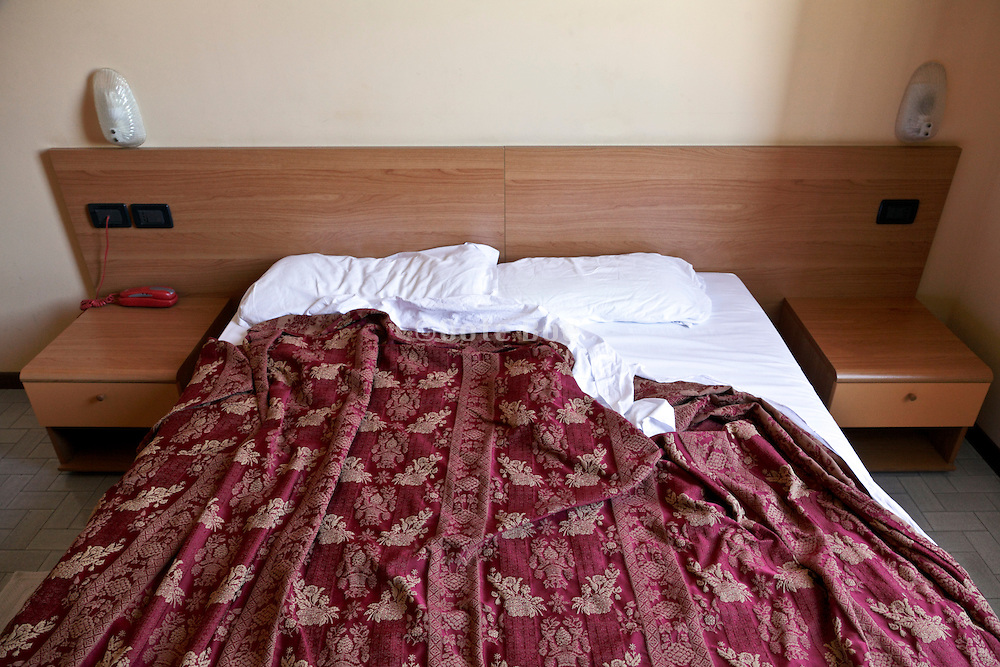 large double bed in hotel room Italy