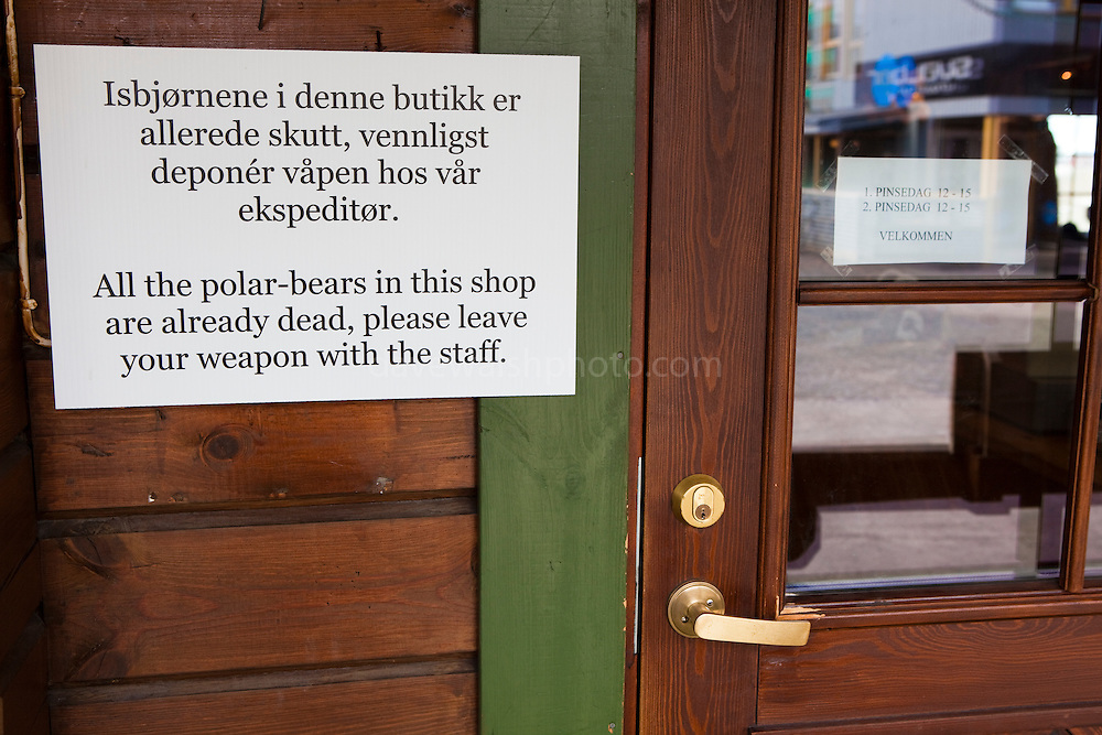 Warning sign, at a souvenir shop in Longyearbyen, Svalbard. The northernmost settlement with more than 1,000 people on earth, and is quite well-serviced town, with an airport and university and hospital.