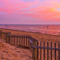 Ablaze skies across Cape Cod Bay and Thumpertown Beach at sunset. This beautiful Cape beach is located in Eastham, Massachusetts and only a few steps from one of Cape Cod's most iconic lighthouses Nauset Beach Light, famous for its logo appearance on the Cape Cod chips.<br />