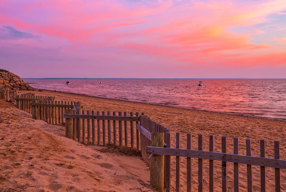 Ablaze skies across Cape Cod Bay and Thumpertown Beach at sunset. This beautiful Cape beach is located in Eastham, Massachusetts and only a few steps from one of Cape Cod's most iconic lighthouses Nauset Beach Light, famous for its logo appearance on the Cape Cod chips.<br /> <br /> New England Cape Cod Bay fine art photography images are available as museum quality photography prints, canvas prints, acrylic prints or metal prints. Fine art prints may be framed and matted to the individual liking and decorating needs:<br /> <br /> https://fineartamerica.com/featured/ablaze-juergen-roth.html<br /> <br /> All New England photos are available for photography image licensing. Please contact Juergen with any questions or request. <br /> <br /> Good light and happy photo making!<br /> <br /> My best,<br /> <br /> Juergen