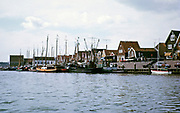View of the village and fishing boats from the sea, Volendam, Netherlands 1973