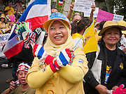 "22 JUNE 2011 - BANGKOK, THAILAND: A Thai Muslim woman who supports the Yellow Shirts calls for a no vote during a pre-election rally in Bangkok on Wednesday, June 22. The PAD (People's Alliance for Democracy) or Yellow Shirts, as they are popularly called, has called for a ""No"" vote in Thailand's national election, scheduled for July 3. PAD leadership hopes the no vote will negate the vote of Yingluck Shinawatra, leader of the Pheua Thai party. Yingluck is the youngest sister of exiled former Prime Minister Thaksin Shinawatra, deposed by a military coup in 2006. Yingluck is currently leading in opinion polls, running well ahead of incumbent Prime Minister Abhisit Vejjajiva, head of the Democrat party, which in one form or another has ruled Thailand for most of the last 60 years.     Photo by Jack Kurtz"