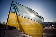 "The ukrainian flag at the barrikades blockading a building supplies store named ""Epicenter"" in the city of Lviv, Ukraine."