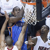 21 June 2012: Oklahoma City Thunder power forward Serge Ibaka (9) grabs an offensive rebound during the Miami Heat 121-106 victory over the Oklahoma City Thunder, in Game 5 of the 2012 NBA Finals, at the AmericanAirlinesArena, Miami, Florida, USA. The Miami Heat wins the series 4-1.