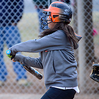 032015  Adron Gardner/Independent<br /> <br /> Gallup JV Bengal J'shon Garnenez chases a Hatch Valley Bears pitch during the Grants Invitational Softball tournament in Grants Friday.