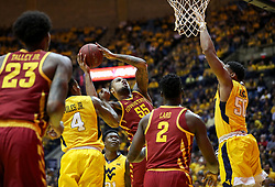 Feb 24, 2018; Morgantown, WV, USA; Iowa State Cyclones forward Jeff Beverly (55) drives into traffic during the first half against the West Virginia Mountaineers at WVU Coliseum. Mandatory Credit: Ben Queen-USA TODAY Sports
