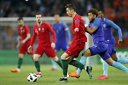 (L-R) Cristiano Ronaldo of Portugal, Tonny Vilhena of Holland during the International friendly match match between Portugal and The Netherlands at Stade de Genève on March 26, 2018 in Geneva, Switzerland
