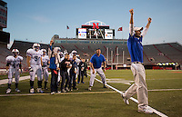 Humphrey St. Francis Head Coach Eric Kessler cheers as the Fylers score late in their D2 championship game against  Chambers/Wheeler Central at Memorial Stadium in Lincoln. Behind 20-6 in the third quarter, Humphrey St. Francis came back and won the championship 22-20.