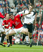 Liverpool's Dietmar Hamann and Manchester United's Roy Keane during the Premiership match at Old Trafford, Manchester, Saturday, March 5th, 2003.<br /><br />Pic by David Rawcliffe/Propaganda<br /><br />Any problems call David Rawcliffe +44(0)7973 14 2020 david@propaganda-photo.com http://www.propaganda-photo.com